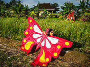 28 JULY 2017 - JEMBRANA, BALI, INDONESIA: People fly kites in a rice field in Jembrana, on the southwest coast of Bali.       PHOTO BY JACK KURTZ