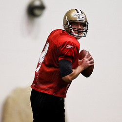 July 31, 2010; Metairie, LA, USA; New Orleans Saints quarterback Sean Canfield (4) during a training camp practice at the New Orleans Saints indoor practice facility. Mandatory Credit: Derick E. Hingle