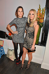 Left to right, LUCY WATSON and TIFFANY WATSON at the Cointreau launch for Yumi by Lilah Parsons SS/16 collection held at 15 Bateman Street, London on 1st December 2015