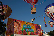 Balloons float overhead during the mass lift-off by balloons at Bristols annual fiesta at Long Ashton, UK.