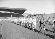 Players walk the pitch before the All Ireland Senior Gaelic Football Final, Down v. Offaly in Croke park on 24th September 1961. Down 3-6 Offaly 2-8.