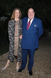 The HON.NICHOLAS SOAMES MP and his wife SERENA at the annual Cartier Chelsea Flower Show dinner held at the Chelsea Physic Garden on 21st May 2007.<br />