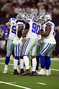 Dallas Cowboys defensive end Demarcus Lawrence (90) huddles with the defense during the NFL football NFC wild card playoff game against the Seattle Seahawks on Saturday, Jan. 5, 2019 in Arlington, Tex. The Cowboys won the game 24-22. (©Paul Anthony Spinelli)