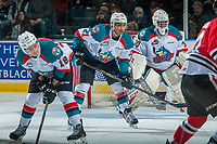KELOWNA, CANADA - JANUARY 21: Carsen Twarynski #18 and Devante Stephens #21 line up in front of Michael Herringer #30 of the Kelowna Rockets against the Portland Winterhawks on January 21, 2017 at Prospera Place in Kelowna, British Columbia, Canada.  (Photo by Marissa Baecker/Getty Images)  *** Local Caption *** Carsen Twarynski; Devante Stephens; Michael Herringer;