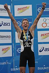 17.07.2010, Hamburg, GER, Triathlon, Dextro Energy Triathlon ITU World Championship, Elite Maenner,  im Bild Jan Frodeno (GER) jubelt ueber den 2. Platz und ueber die Fuehrung in der Gesamtwertung mit der Siegerkugel.EXPA Pictures © 2010, PhotoCredit: EXPA/ nph/  Witke+++++ ATTENTION - OUT OF GER +++++ / SPORTIDA PHOTO AGENCY