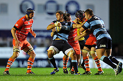 Josh Navidi (Blues) is tackled in possession by Tom Bristow (Leicester) - Photo mandatory by-line: Patrick Khachfe/JMP - Mobile: 07966 386802 29/08/2014 - SPORT - RUGBY UNION - Leicester - Welford Road - Leicester Tigers v Cardiff Blues - Pre-Season Friendly