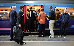 Embargoed to 0001 Monday May 22 File photo dated 15/09/14 of commuters on a train, as long commutes are hitting the health and productivity of workers, leading to stress and depression, a report says.