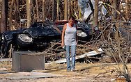Sheryl Busby of Ocean Springs looks for personal items in a field of debris Saturday, September 10, 2005 where her home used to stand. Sheryl and her husband Tim were able to evacuate before the storm but have lost everything...John Pavoncello photo