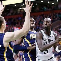 04 January 2013: Boston Celtics power forward Kevin Garnett (5) looks to pass the ball past Indiana Pacers center Ian Mahinmi (28) and Indiana Pacers power forward Tyler Hansbrough (50) during the Boston Celtics 94-75 victory over the Indiana Pacers at the TD Garden, Boston, Massachusetts, USA.