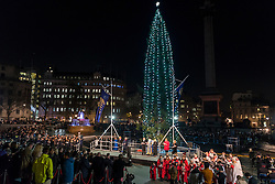 © Licensed to London News Pictures. 01/12/2016. London, UK. A 22-metre tall Norwegian spruce, decorated in a traditional Norwegian style with vertical strings of lights (around 770 energy-efficient light bulbs) is lit up in Trafalgar Square.  The tree is the city of Oslo's traditional Christmas gift to London as a token of thanks for British support during the years of occupation.  The Lord Mayor of Westminster, Councillor Steve Summers hosted the Mayor of Oslo, Marianne Borgen who performed the official lighting up. Photo credit : Stephen Chung/LNP
