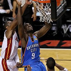 Jun 21, 2012; Miami, FL, USA; Oklahoma City Thunder power forward Serge Ibaka (9) shoots over Miami Heat shooting guard Dwyane Wade (3) during the third quarter in game five in the 2012 NBA Finals at the American Airlines Arena. Mandatory Credit: Derick E. Hingle-US PRESSWIRE