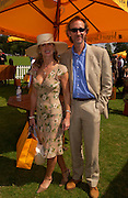 Mike and Angie Rutherford, Veuve Clicquot gold Cup, Polo at Cowdray, 18 July 2004. SUPPLIED FOR ONE-TIME USE ONLY> DO NOT ARCHIVE. © Copyright Photograph by Dafydd Jones 66 Stockwell Park Rd. London SW9 0DA Tel 020 7733 0108 www.dafjones.com