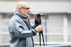 London, November 28th 2015. As Prime Minister David Cameron pushes for Parliament to vote to allow aerial strikes against Islamic State targets in Syria, Britain's Stop The War Coalition and thousands of anti-war protesters demonstrate outside Downing Street. PICTURED:  Musician and producer Brian Eno addresses the crowd. //// FOR LICENCING CONTACT: paul@pauldaveycreative.co.uk TEL:+44 (0) 7966 016 296 or +44 (0) 20 8969 6875. ©2015 Paul R Davey. All rights reserved.