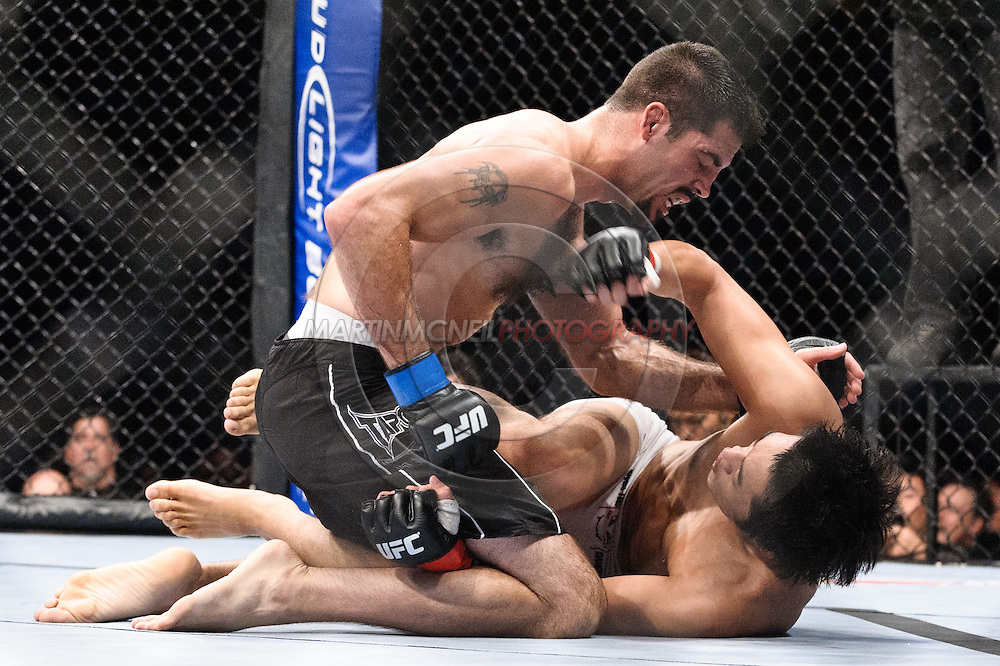 """ATLANTA, GEORGIA, SEPTEMBER 6, 2008: Matt Brown (top) has his chin clipped by a punch from Dong Hyun Kim during """"UFC 88: Breakthrough"""" inside Philips Arena in Atlanta, Georgia on September 6, 2008"""