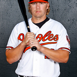 February 26, 2011; Sarasota, FL, USA; Baltimore Orioles third baseman Mark Reynolds (12) poses during photo day at Ed Smith Stadium.  Mandatory Credit: Derick E. Hingle