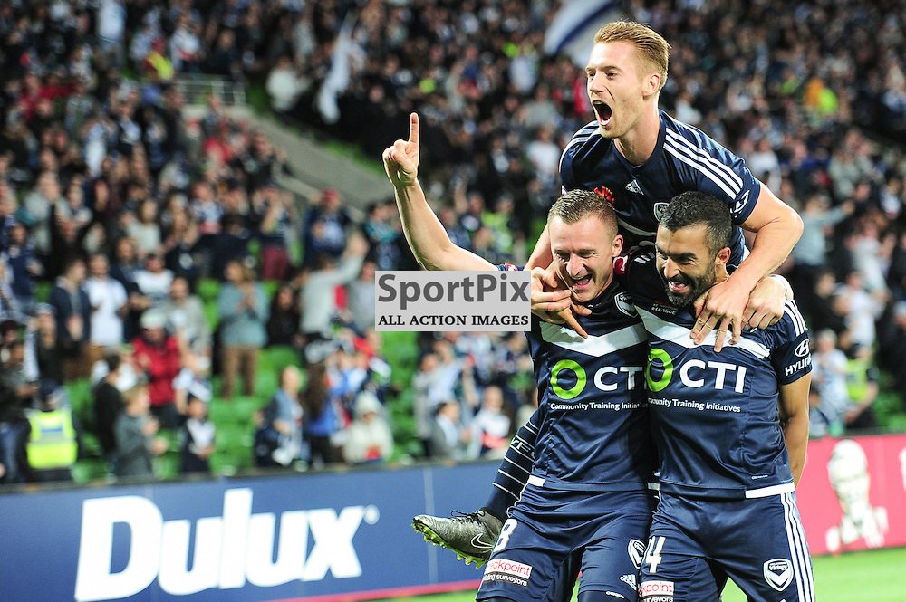 Besart Berisha of Melbourne Victory celebrates scoring the deciding goal of with Oliver Bozanicn of Melbourne Victory, Fahid Ben Khalfallah in the Hyundai A-League, January 15th 2016, RD15 match between Melbourne Victory FC v Brisbane Roar  FC in a 4:0 win to Victory in a comfortable win over Roar at Aami Park,  Melbourne, Australia. © Mark Avellino | SportPix.org.uk