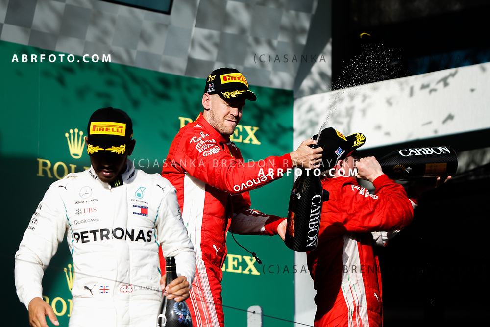 Victorious Ferrari driver Sebastian Vettel of Germany celebrates spraying champagne on the podium during the trophy presentation at the end of the 2018 Rolex Formula 1 Australian Grand Prix at Albert Park, Melbourne, Australia, March 24, 2018.  Asanka Brendon Ratnayake