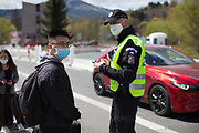A you man is getting checked and registrated by the Czech border police before crossing the closed state border in between Germany and Czech Republic in Bayerisch Einsenstein after the corona virus outbreak changed our public lifes. Czech Republic is in the state of emergency and just their own citizens or foreigners with a residence permit are allowed to enter.