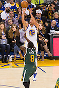 Golden State Warriors guard Stephen Curry (30) shoots a three pointer against the Utah Jazz at Oracle Arena in Oakland, Calif., on December 20, 2016. (Stan Olszewski/Special to S.F. Examiner)
