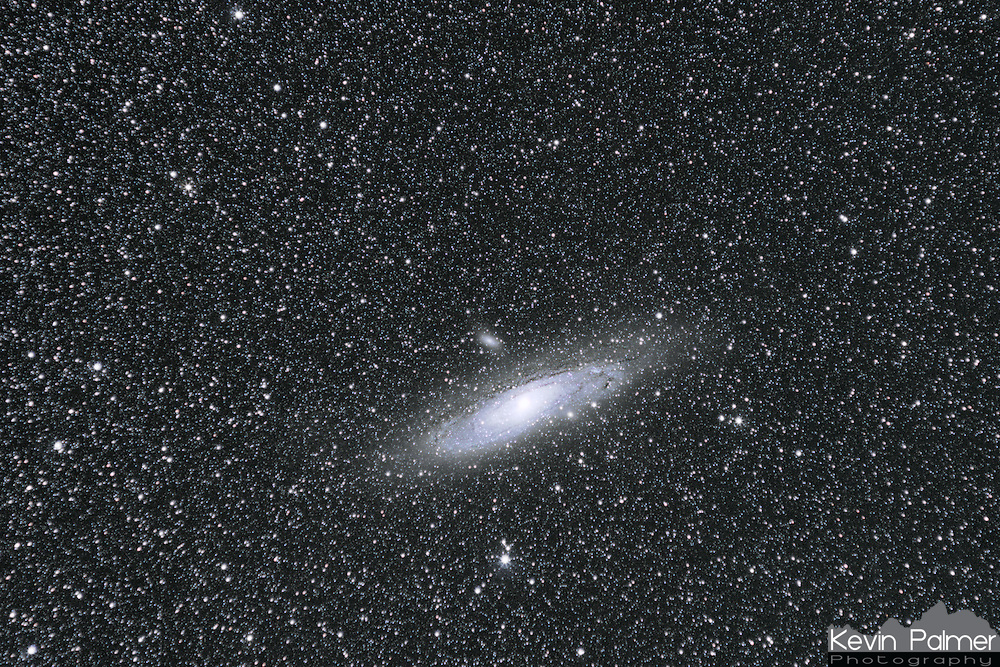 The Andromeda Galaxy, despite being  2.5 million light years away, is the biggest and brightest in our sky. It covers an area several times bigger than the diameter of a full moon. If you go to even a moderately dark location it is easy to spot with the naked eye. Several satellite galaxies can also be seen in this picture. This was taken in the Bitterroot Mountains in Idaho which has some of the darkest skies I've ever photographed.