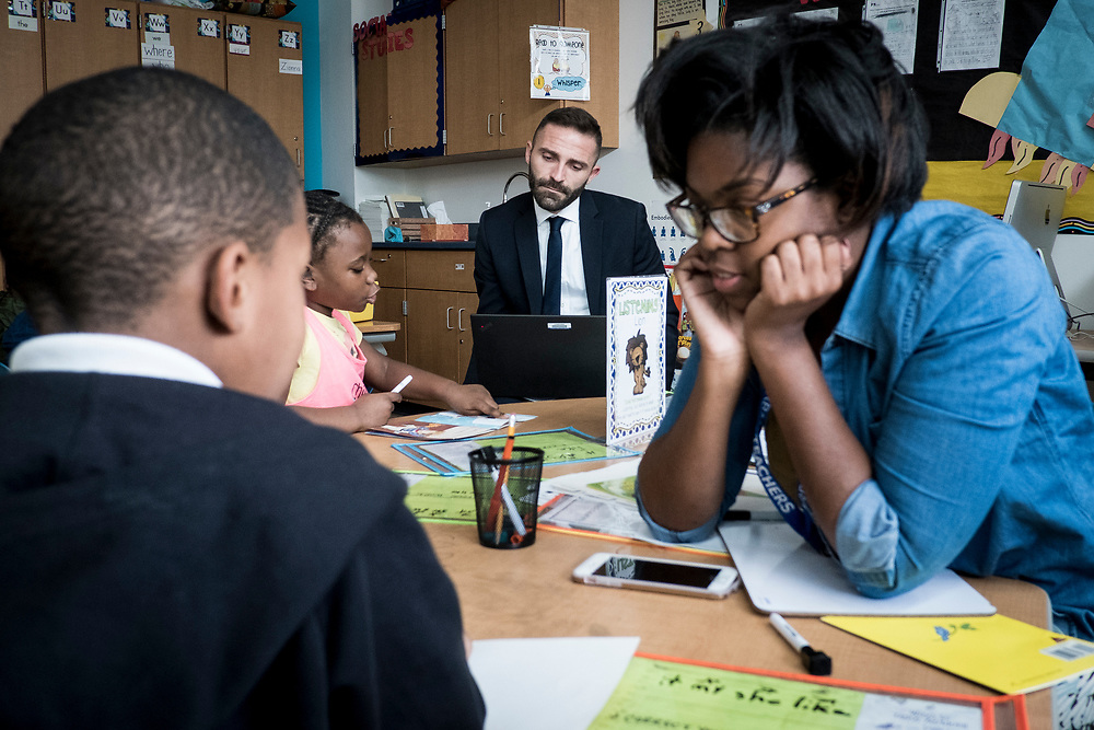 Eric Christopher, Leap ELA Instructional Coach at Turner Elementary School in Washington, D.C., looks over a student's work during class on Wednesday, May 4, 2017.