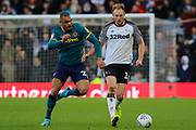 Hull City forward Josh Magennis and Derby County defender Matthew Clarke challenge for the ball during the EFL Sky Bet Championship match between Derby County and Hull City at the Pride Park, Derby, England on 18 January 2020.