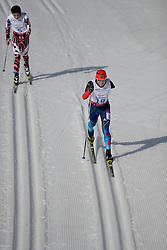 TIAN Ye, LEKOMTCEV Vladislav competing in the Nordic Skiing XC Long Distance at the 2014 Sochi Winter Paralympic Games, Russia
