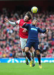Arsenal's Tomas Rosicky and Blackburn Rovers' Martin Olsson challenge for the ball in the air - Photo mandatory by-line: Dougie Allward/JMP - Tel: Mobile: 07966 386802 16/02/2013 - SPORT - FOOTBALL - Emirates Stadium - London -  Arsenal V Blackburn Rovers - FA Cup - Fifth Round