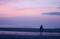 New York, Long Island - walking into the sunset along the beach.
