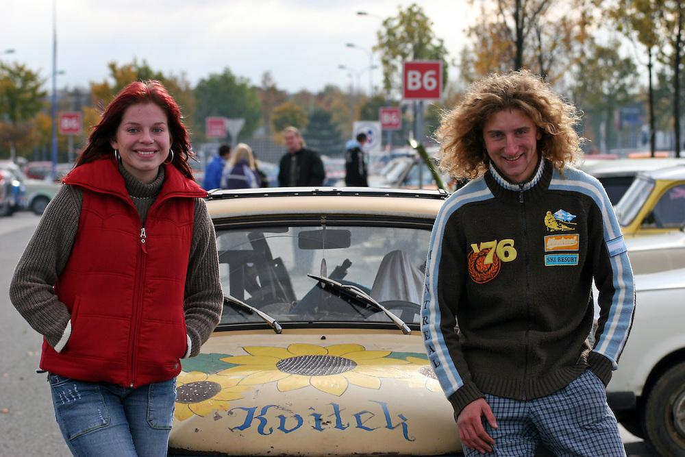 9. Herbst Treffen der Trabant Fahrer zum traditionellen Ausklingen der Auto Saison 2007 in Prag.Der 20 j&auml;hrige Milos Kulich mit seiner Freundin Simona Gieblova (18)  vor seinem Trabant &quot;Bl&uuml;mchen&quot;.  Ein halbes Jahrhundert ist vergangen, seit 1957 die Nullserie des Trabant P50 die Werkhallen in Zwickau verliess. Bis 1991 wurden &uuml;ber 3 Millionen Trabant produziert, der Trabant geh&ouml;rte &uuml;ber Jahrzehnte zum Stra&szlig;enbild vieler europ&auml;ischer L&auml;nder.  <br /> <br /> 9th Trabant driver meeting and end of the car season 2007 in Prague. 20 years old Milos Kulich and his girlfriend Simona Gieblova (18) in front of his Trabant &quot;Floret&quot;.
