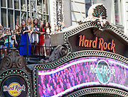 "Fifth Harmony waves to fans at Hard Rock Cafe New York, Thursday, Aug. 27, 2015, to celebrate the release of their music video for their song, ""I'm In Love with a Monster."" (Photo by Diane Bondareff/Invision for Hard Rock International/AP Images)"