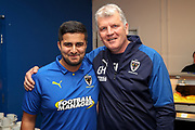 AFC Wimbledon manager Glyn Hodges with AFC Wimbledon fan prior to kick off during the EFL Sky Bet League 1 match between AFC Wimbledon and Blackpool at the Cherry Red Records Stadium, Kingston, England on 22 February 2020.