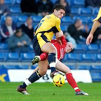 Photo: Daniel Hambury.<br />Oxford Utd v Wrexham. Coca Cola League 2.<br />12/11/2005.<br />Oxford's Jon Ashton (L) and Wrexham's Lee McEvilly battle for the ball.