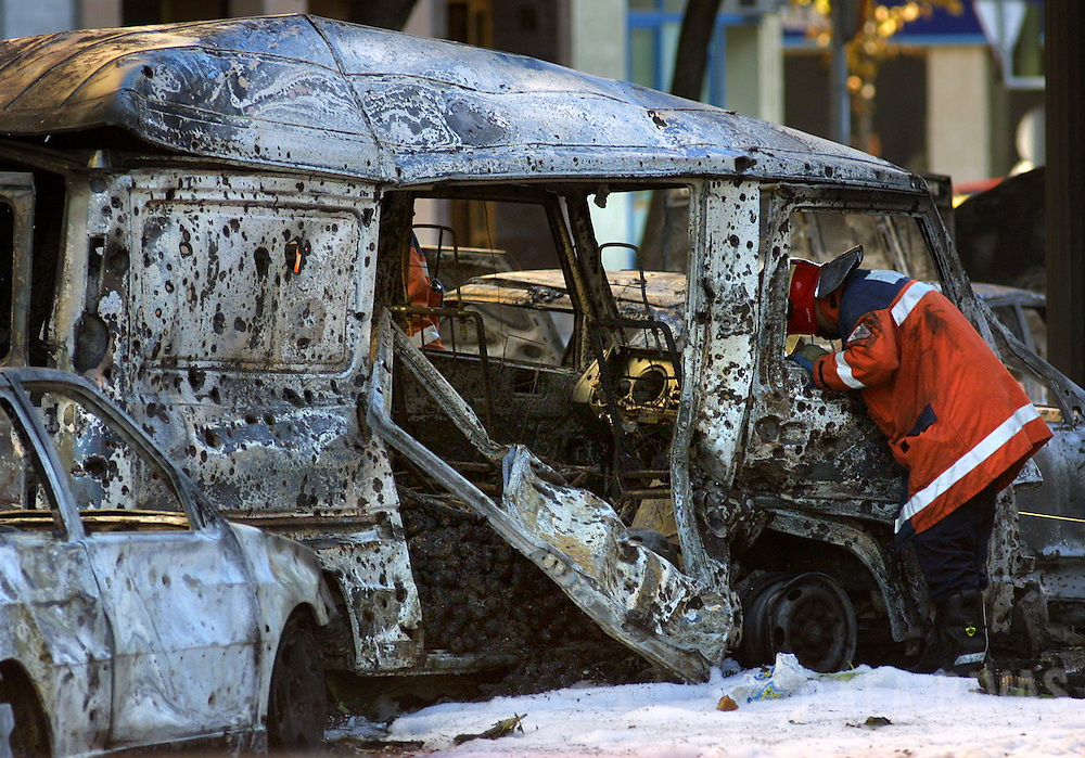 A fireman inspects burnt cars wreckage, destroyed by a bomb by Basque separatist terrorist group ETA, that exploded against the northern Spanish Basque city of Vitoria's Court House, on October 1, 2001.