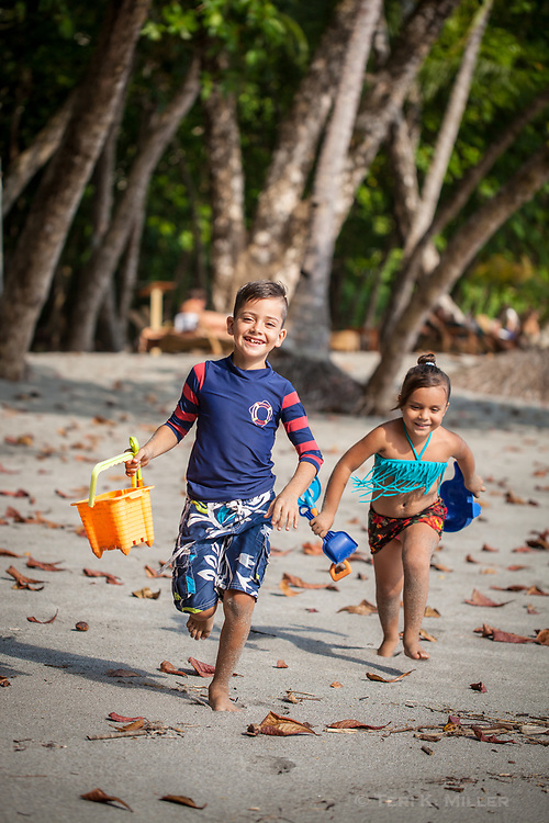Children play at Playitas Beach at Arenas del Mar Resort, Manuel Antonio, Costa Rica.