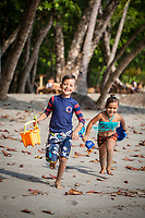 Children play at Playitas Beach at Arenas del Mar Resort, Manuel Antonio, Costa Rica.