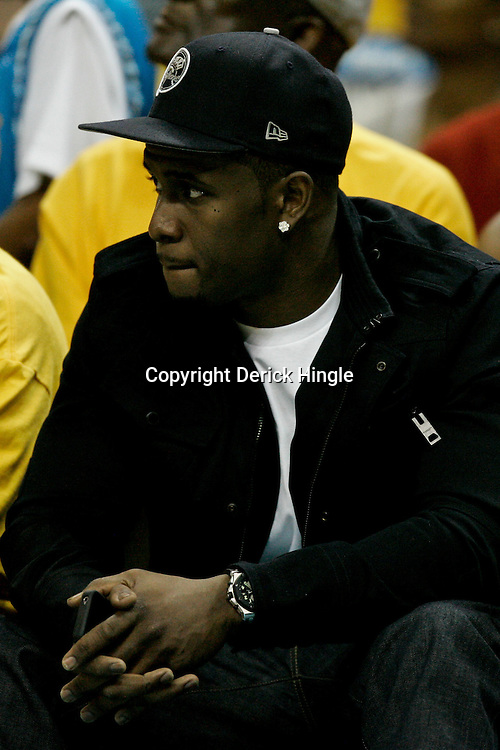 April 22, 2011; New Orleans, LA, USA; Reggie Bush watches courtside during the first half in game three of the first round of the 2011 NBA playoffs between the New Orleans Hornets and the Los Angeles Lakersat the New Orleans Arena. The Lakers defeated the Hornets 100-86.   Mandatory Credit: Derick E. Hingle