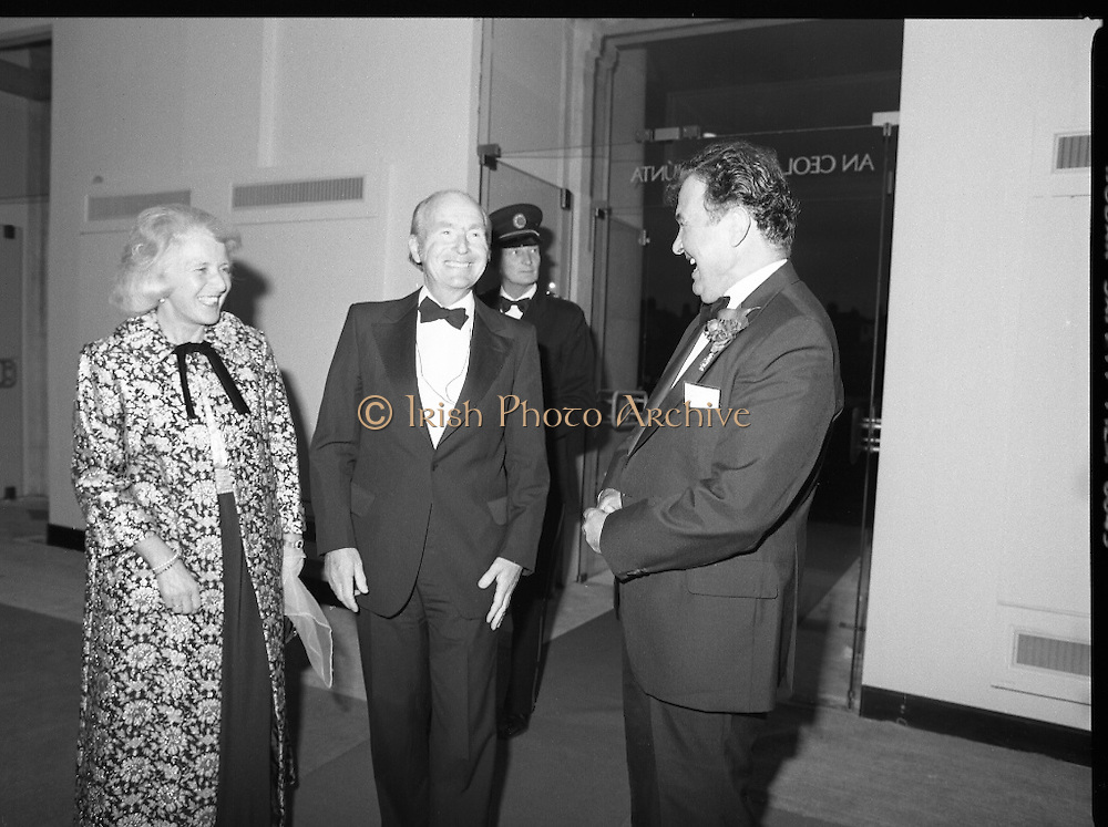 State Opening Of The National Concert Hall. (N92)..1981..09.09.1981..9th September 1981..The President ,Dr Patrick Hillery, officially opened the new National Concert Hall,Earlsfort Terrace, Dublin. The state opening was followed by the premier concert performed by the Radio Telefís Eireann Symphony Orchestra with a large cast of soloists, choirs and the RTESO leader Audrey Park and conducted by RTE's Principal conductor Colman Pearce...President and Mrs Hillery are pictured on their arrival at the National Concert hall for the State Opening. Mr Fred O'Donovan is seen escorting them into the hall.