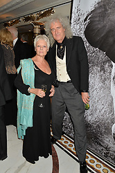 DAME JUDI DENCH and BRIAN MAY at the David Shepherd Wildlife Foundation 30th anniversary Wildlife Ball at The Dorchester, Park Lane, London on 10th October 2014.