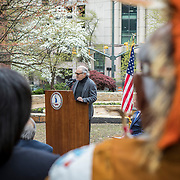 Alan Michelson, a Mohawk member of Six Nations of the Grand River, speaks during the dedication ceremony for Mantle: Virginia Indian Tribute, a monument designed on Virginia State Capitol Square, in Richmond, Virginia, on Tuesday, April 17, 2018. Michelson, a New York based artist, designed the monument in Capitol Square next to the Bell Tower along North Ninth Street. John Boal Photography