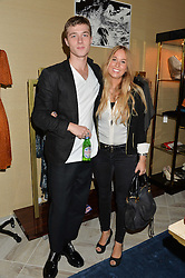 WILL FARRELL and GIORGINA ATKINSON-REED at a party to celebrate the launch of Baar & Bass, 336 Kings Road, London on 9th September 2014.