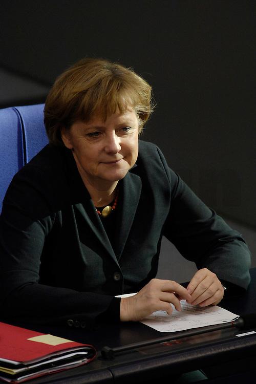 09 FEB 2006, BERLIN/GERMANY:<br /> Angela Merkel (R), CDU, Bundeskanzlerin, waehrend einer aktuelle Stunde zur Erhoehung des Renteneintrittsalters auf 67 Jahre, Plenum, Deutscher Bundestag<br /> IMAGE: 20060209-02-056