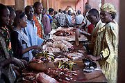 Tables of beef viscera for sale in N'Djamena, Chad. (From a photographic gallery of meat and poultry images, in Hungry Planet: What the World Eats, p. 164).