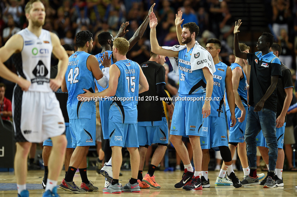 Breakers players celebrate winning the SkyCity Breakers v Melbourne United match. 2014/15 ANBL Basketball Season. Vector Arena, Auckland, New Zealand. Sunday 18 January 2015. Copyright Photo: Andrew Cornaga / www.photosport.co.nz