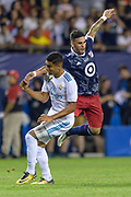 CHICAGO, IL - AUGUST 02: MLS All-Star and Orlando City FC Forward Dom Dwyer (14) and Real Madrid midfielder Casemiro (14) collide in the second half in the second half during a soccer match between the MLS All-Stars and Real Madrid on August 02, 2017, at Soldier Field in Chicago, IL. The game ended in a 1-1 tie with Real Madrid winning on penalty kicks 4-2. (Photo By Daniel Bartel/Icon Sportswire)