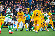 Ricki Lamie (#5) of Livingston FC is led away by referee Willie Collum during the Ladbrokes Scottish Premiership match between Livingston FC and Celtic FC at The Tony Macaroni Arena, Livingston, Scotland on 6 October 2019.