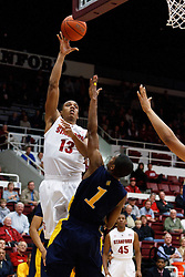 December 15, 2010; Stanford, CA, USA;  Stanford Cardinal forward/center Josh Owens (13) shoots over North Carolina A&T Aggies forward Adrian Powell (1) during the first half at Maples Pavilion.