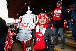 A young Bristol City fan poses with a cardboard FA Cup before the match - Photo mandatory by-line: Rogan Thomson/JMP - 07966 386802 - 25/01/2015 - SPORT - FOOTBALL - Bristol, England - Ashton Gate Stadium - Bristol City v West Ham United - FA Cup Fourth Round Proper.