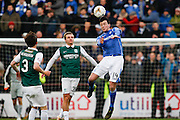 St Johnstones Joe Shaughnessy jumps for the ball during the Scottish League Cup semi-final match between Hibernian and St Johnstone at Tynecastle Stadium, Gorgie, Scotland on 30 January 2016. Photo by Craig McAllister.
