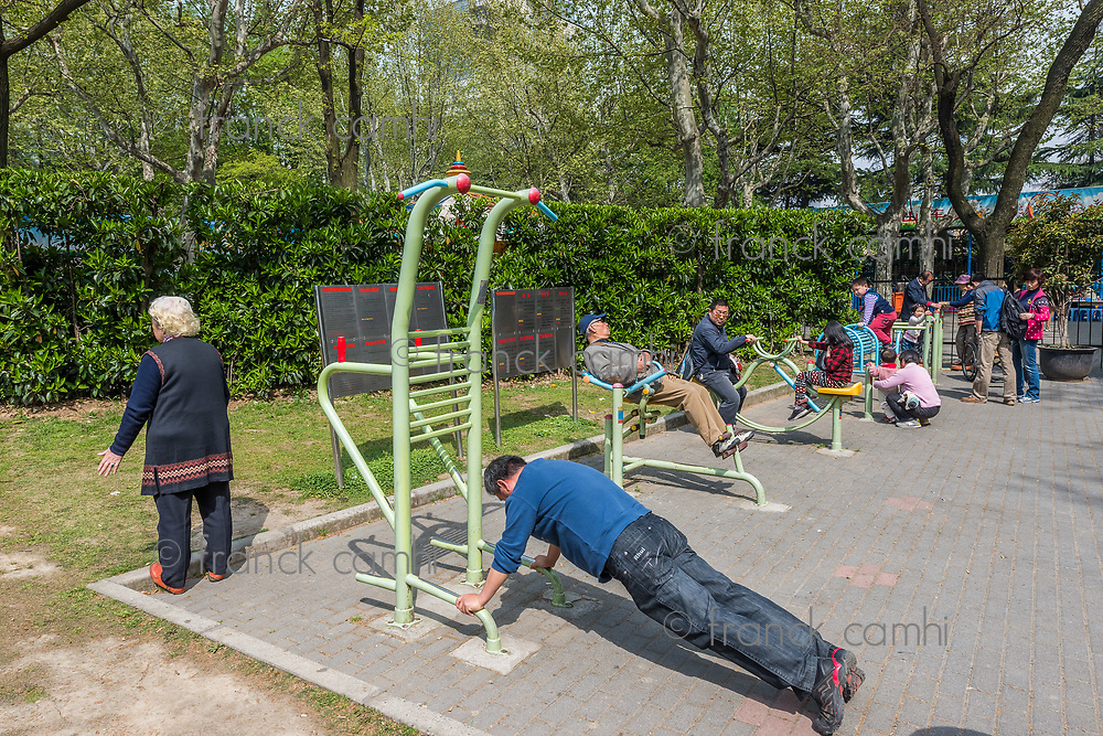 Shanghai, China - April 7, 2013: group of people exercising in fuxing park at the city of Shanghai in China on april 7th, 2013